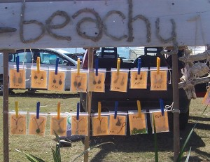 selling earrings and necklaces at the East London beachfront flea market