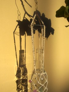 bottle windchime and silhouette against yellow wall