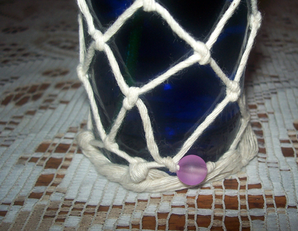 one bead on a bottle vase