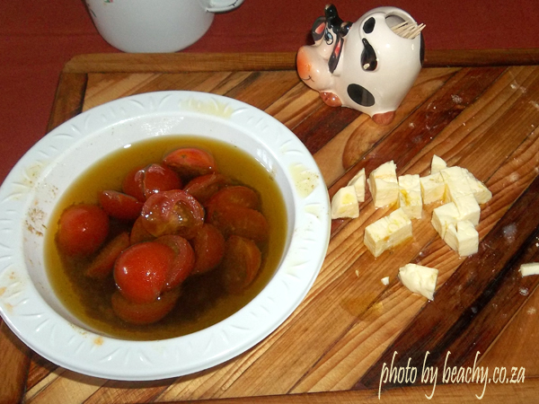 olive oil and herb and cherry tomato dressing with feta cheese