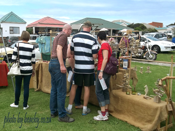 people looking at the Beachy market stall in Kidds Beach