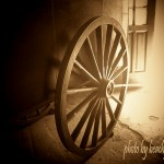 sepia photo wagon wheel at the Blue Barn