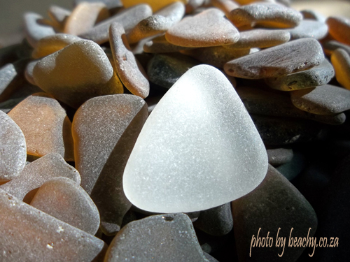 white sea glass on brown sea glass pieces
