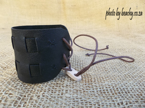 black leather bracelet with adjustable size slider on brown waxed cord