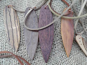 different woods wood surfboard necklaces