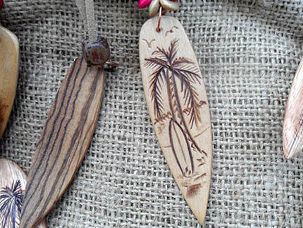 wooden surfboard necklace with surfboard
