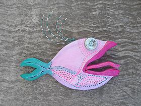 pink fish pulling a tongue