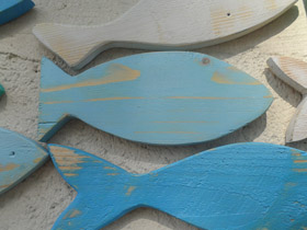pale blue wooden fish