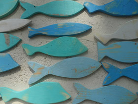 wooden fish on a wall