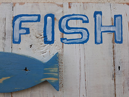 Two less fish in the sea wooden sign